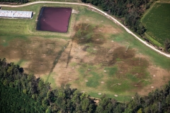 Aerial view of manure being sprayed onto fields. North Carolina, USA.