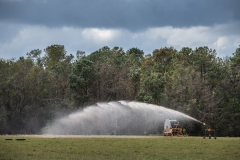Manure being sprayed on a field next to Elsie Herring's family home. North Carolina, USA.