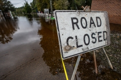 Road Closed sign at the edge of the floodwater in Fair Bluff after Hurricane Florence. North Carolina, USA.